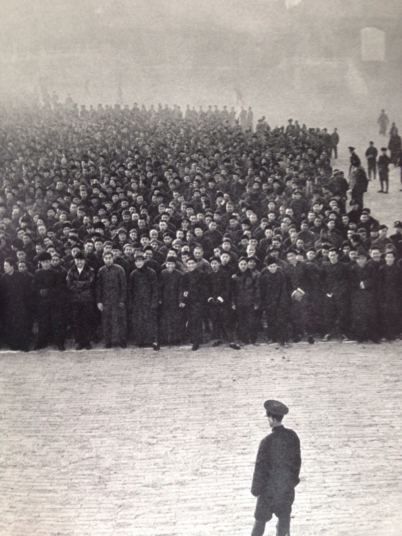 Eight o'clock in the moring at the Imperial Palace in Peking.  Ten thousand recruits, mobilized principally from the ranks of small traders, line up to form a new Nationalist regiment.