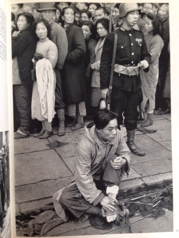 Shanghai, December 1948.  The gold rush.  Enormous lines form outside the banks, on the Bund, and overflow into the neighbouring streets, dislocating all traffic.  About ten people were crushed to death.  The Kuomintang had decided to distribute some of the gold reserve, at the rate of 112 ounces per head.  Some people waited for more than twenty-four hours trying to get rid of paper money.  Order was more or less maintained by soldiers equipped with odds and ends deriving from all the various armies which in the past fifteen years, have played a part in Chinese history.